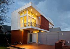 Fachada de casa residencial de dos niveles
