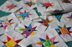"These little blocks are made from 1 1/2"" squares. Such an amazing way to use up leftover fabrics! from A Little Red Hen"
