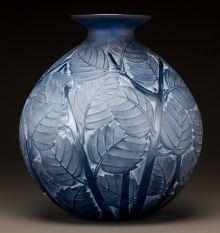 Art Glass:Lalique, R. LALIQUE BLUE GLASS MILAN VASE WITH WHITE PATINA. Circa1929. Molded R. LALIQUE. M p. 444, No. 1025. Ht. 1...