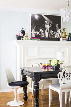 casual glam dining room | mantle styling | black dining table with white chairs