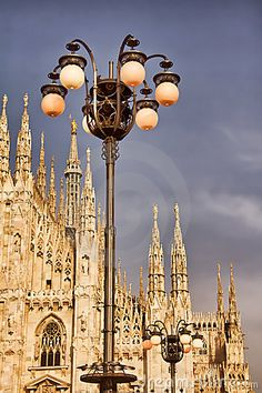 Photo of street lights in Milan, Italy, Milan Cathedral, also known as Duomo Di Milano on the background