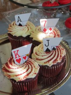 Red velvet with almond buttercream topped with a playing card.