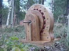 Not particularly delicate, but as a piece of engineering it's stunning; a timber alternator! For off-grid power generation!
