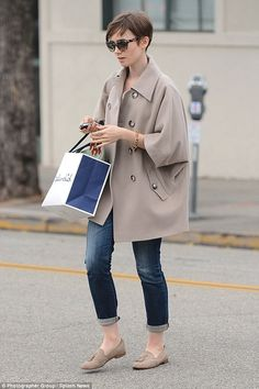 Stylish: The Love, Rosie actress wore an oversized taupe coat with jeans and suede tasseled loafers