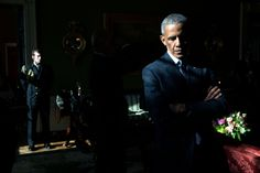 """""""With sunlight streaming through a window in the Green Room, President Obama listens to his introduction by Mark Barden, whose 7-year-old son Daniel was killed during the 2012 shooting at Sandy Hook Elementary School in Newtown, Conn. Later, as he made remarks in the East Room, he began to cry as he recalled the day of the shootings; he called it the worst day of his Presidency."""" (Official White House Photo by Pete Souza)"""