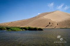 Badain Jaran, China - The dunes of Badain Jaran are over 1,640 feet (500 meters) in height, making them the world's tallest set of stationary dunes. Despite windy conditions, they are anchored in place by an underground water source. The dunes whistle, sing and boom. The sound is produced when the top layer of sand is whipped off the layer below it by desert winds and makes a deep, rumbling sound that can reach 105 decibels.