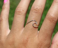 This is a wire ring in the shape of a single ocean wave! It is made out of sterling silver wire. A perfect ring to show your love for summer and