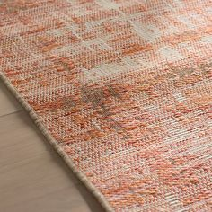 <p>Instantly warm up any floor space - indoors or out! - while also adding rustic charm with this eye-catching area rug.</p><p>Made in Belgium, this essential accent is machine loomed of 100% polypropylene so it can stand up to natural damage from sunlight and rain. Brimming with artful appeal, it features a distressed woven design in hues of burnt orange and white.</p><p>This decorative design is a lovely foundation for your farmhouse-inspired ensemble...