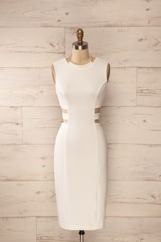 Les Prêtresses de la Modernité ont le cou cerclé d'or et l'esprit ouvert sur l'infini.    The Priestesses of Modernity have the neck adorned with gold and the mind open to the infinite. White cut-outs golden halter midi dress www.1861.ca