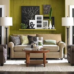 over the sofa wall shelf   LivingRoom – I love the layering on the shelf behind the couch