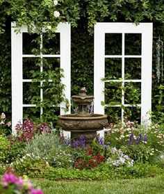 Wooden doors become a garden accent or privacy screen