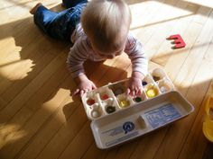 Glue differently textured items into the bottom of an egg carton to create a sensory toy for baby to poke at