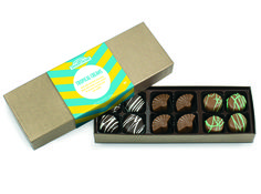 RMCF Tropical Creams Assortment contains 12 assorted chocolates including: four dark Coco Loco™ Creams, four milk Key Lime Mountain Creams, and four rum truffle filled milk chocolate fans.
