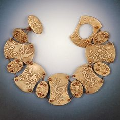 Beautiful bronze clay bracelet by Vickie Hallmark.