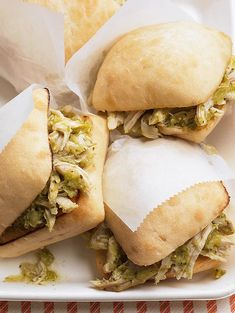 """Since the tomatillo chicken for these pulled chicken sandwiches starts with rotisserie meat, prep work is simple. Then, this chicken recipe continues on the """"easy"""" motif with a three-step slow cooker method. Roast Chicken Sandwiches, Chicken Sandwich Recipes, Wrap Sandwiches, Healthy Sandwiches, Slow Cooker Recipes, Crockpot Recipes, Cooking Recipes, Batch Cooking, Slow Cooking"""