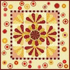 Vintage Dresden Quilt | Take a traditional Dresden Plate block, add blades, divide it in half, in fourths and scatter these new blocks in a contemporary layout!