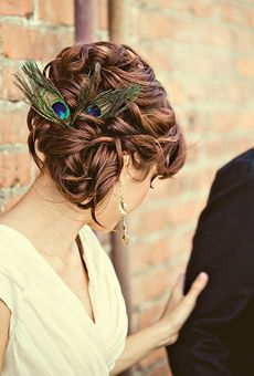 *Wedding/Prom updo with peacock feather accents *