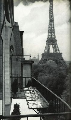 A view of Paris- I love the eating area table on the balcony.