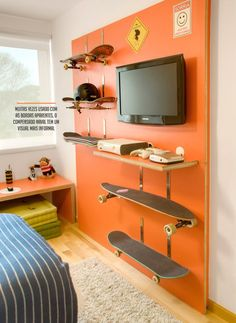 12 - In this contemporary room,an accent wall is painted in bright orange for happiness and a warm feel. The skateboard shelves are quite interesting and add a sporty, extrovert and uninhibited look which suits the personality of the sports lover boy. Skateboard Shelves, Boys Skateboard Room, Skateboard Furniture, Teenage Room, New Room, Girls Bedroom, Teen Boy Bedrooms, Trendy Bedroom, Orange Boys Bedrooms