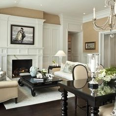 Modern British colonial influence..dark wood floors, furniture, Asian style coffee table, turned legs on dining table..