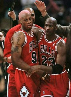 James Edwards, Dennis Rodman, and the GOAT celebrate win number 70 in Milwaukee.