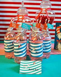 donated water bottles. pink lemonade flavoring. Attach printed labels.  Make your own Pink Ink.