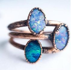 A small oval Australian opal has been electroformed to a hand hammered 16 gauge copper ring. Every stone is as unique as the person it will adorn. Please allow for differences in color, shape and size