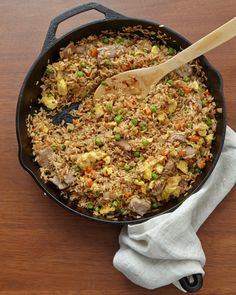 Tasty slivers of pork shoulder and seasonings of ginger, garlic, soy sauce, and fiery Chinese chile paste add a Szechuan flair to fried rice.
