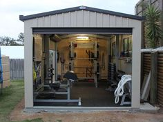 This is a nice shed garage gym - power rack, dumbbells, GHD, even a battle rope. very nice gym #shedgym