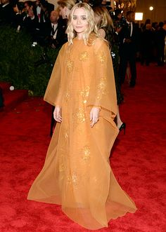 Met Gala 2013: Most Outrageous Punk-Inspired Outfits: Ashley Olsen designer chose a vintage Christian Dior Haute Couture gown, which she paired with Manolo Blahnik heels and Sidney Garber earrings.