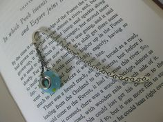 Pretty metal bookmark with blue glass bead by Trudysbeads on Etsy