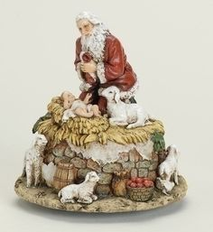 Kneeling Santa With Baby Jesus Musical Christmas Figure  Plays Come All Ye Faithful