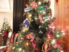 This Tree was decorated with Cub Scout Badges. all done by and grade Scouts from Wauwatosa Cub Scout Badges, Cub Scouts, Leukemia And Lymphoma Society, Trees, Christmas Tree, Holiday Decor, Teal Christmas Tree, Tree Structure, Xmas Trees