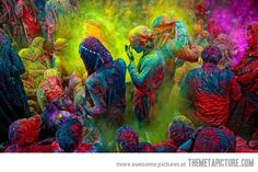 In India they do this. Throwing colored pigment (chalk?) at eachother. Saw it in the movie Outsourced. Title: Color war