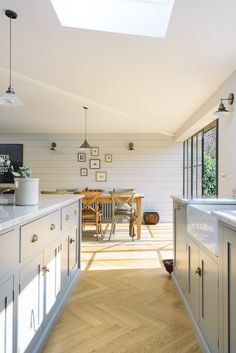 Crittall style windows flood the Chester Kitchen with light and the cladded back wall ties the whole space together, we love it