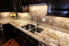 Practically glowing granite kitchen countertops. Fabricated and installed by Premier Granite & Stone.
