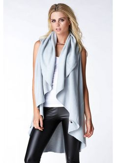 An amazing shawl vest that has multiple functions! Now when we say amazing, we mean it! This shaw...