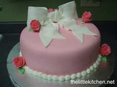 Beautiful in its simplicity.  The pink cake with a fondant ribbon & roses.
