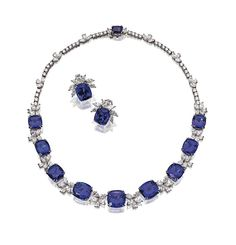 TANZANITE & DIAMOND NECKLACE & MATCHING EARCLIPS, TIFFANY & CO.    The necklace set with 10 cushion-shaped tanzanites spaced by florets of marquise-shaped & pear-shaped diamonds mounted in platinum, length 15½ inches; the earclips set with 2 cushion-shaped tanzanites & 14 marquise-shaped & pear-shaped diamonds, all mounted in platinum, signed Tiffany & Co.