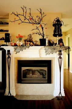 Great idea mantel.  Love the branch!  10 Extravagant Ways To Decorate For Halloween