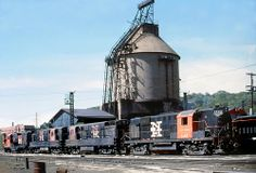 New Haven Railroad locomotives are seen near the old coaling tower in the Cedar Hill Yard at New Haven, Connecticut, early 1960's, Mac Seabree Collection