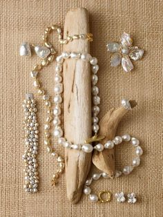 """Like all natural pearls, Keshis, or """"chance"""" pearls, are all nacre, iridescent layers of mother-of-pearl. Clockwise from Top Left: Stephen Russell's baroque pearl earrings in 18k gold. Chanel's keshi pearl necklace with Camelia clasp in 18k gold. Russell Trusso's freshwater keshi, 18mm baroque South Sea p..."""
