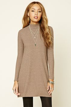 Style Deals - A ribbed knit swing dress featuring a mock neckline and long sleeves.
