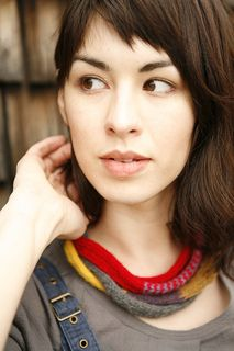 A coil of striped i-cord can be worn as a mini-scarf or as a headband.