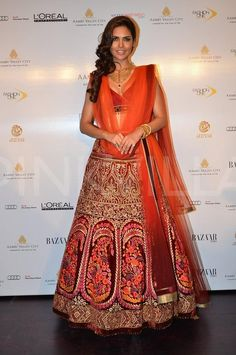 Esha Gupta in orange lehenga #lehenga #choli #indian #hp #shaadi #bridal #fashion #style #desi #designer #blouse #wedding #gorgeous #beautiful