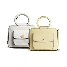 Odette Bag - Blumarine Spring Summer 2016 • Blumarine's white and yellow leather city bag has been crafted in Italy. Designed with a boxy style, it has top handles, a detachable shoulder strap and outside pocket.