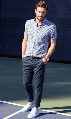 White Sneakers styled with Navy and White Short Sleeve Shirt, Navy Chinos and Brown Woven Leather Belt