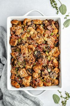Delicious parmesan bacon mushroom stuffing made with sourdough bread and toasty pecans in every bite. This amazing homemade mushroom stuffing recipe is filled with flavor from fresh herbs and melted cheese that will have you going back for seconds. The perfect twist on a classic Thanksgiving side dish! #stuffing #thanksgiving #sidedish...