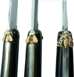 The bee, one of the symbols of a Forge de Laguiole knife, is chiselled with a file and a punch by the cutlers of the factory. Forge De Laguiole, Knife Stand, Napoleon Iii, French Empire, Four Leaf Clover, Custom Knives, Knife Making, Folding Knives, Coat Of Arms