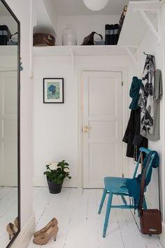 Blue chair, white floors.